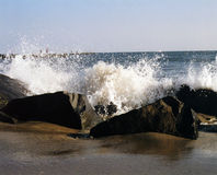 Cape May Splash. Water splashing against the rocks on Cape May beach in New Jersey Royalty Free Stock Photography