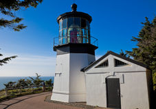 Cape Meares lighthouse. Exterior of Cape Meares lighthouse with blue sky and sea in background, Oregon, U.S.A Stock Image