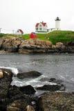 Cape Neddick Lighthouse, Maine. The Cape Neddick Nubble is a small, rocky island a short distance off the eastern point of Cape Neddick near the entrance to the Stock Photos