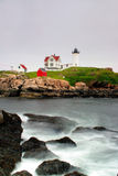 Cape Neddick Lighthouse, Maine. The Cape Neddick Nubble is a small, rocky island a short distance off the eastern point of Cape Neddick near the entrance to the Royalty Free Stock Photos