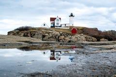 Cape neddick lighthouse reflection. Cape neddick lighthouse York Maine Royalty Free Stock Images