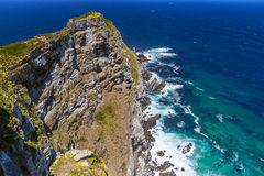 Cape Point. Republic of South Africa. Dramatic cliff of the Cape Point the most south-western point of the African continent and turbulent waters of Atlantic stock photos
