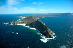Cape Point (South Africa). Cape Point is a promontory at the south-east corner of the Cape Peninsula, which is a mountainous and very scenic landform that runs stock photo