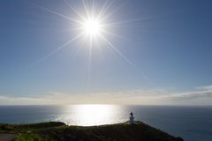 Cape Reinga lighthouse in backlight Royalty Free Stock Image
