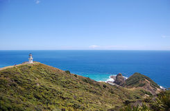 Cape Reinga lighthouse hilly sea coast Royalty Free Stock Photography