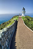 Cape Reinga lighthouse - New Zealand. The Cape Reinga lighthouse is one of the most important landmarks of Te Paki in New Zealand and stands on the edge of a Stock Photo