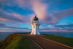 Cape Reinga, north edge of New Zealand, meets here Indian and Pacific oceans meets here. Beautiful seascape with lighthouse. stock photos