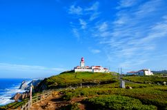 Cape Roca lighthouse. Cabo da Roca most western point in Europe. Travel tourism landmark in Sintra and Lisbon, Portugal. Cape Roca and old red lighthouse. Cabo stock photography