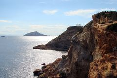Cape Sounion of the southern part of mainland Greece. 06. 20. 2014. Marine landscape and landscape of the desert vegetation of the royalty free stock photos
