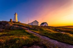 Cape Spear Lighthouse at Newfoundland. View of Cape Spear Lighthouse at Newfoundland, Canada, during sunset stock images