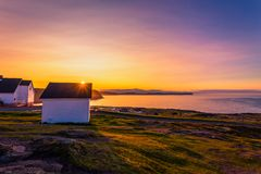 Cape Spear Lighthouse at Newfoundland. View of Cape Spear Lighthouse at Newfoundland, Canada, during sunset stock photos