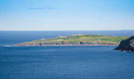 Cape Spear seen from Signal Hill. Calm Atlantic Ocean. Cape Spear seen from Signal Hill.  Panoramic vista - bright, blue summer sky looking out over the Atlantic Royalty Free Stock Image