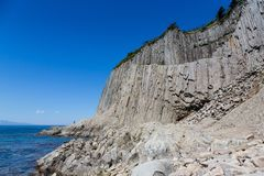 Cape Stolbchaty. Cape on the west coast of the island of Kunashir. It is composed of layers of basaltic lavas of the Mendeleyev v. Olcano royalty free stock photos