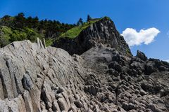 Cape Stolbchaty. Cape on the west coast of the island of Kunashir. It is composed of layers of basaltic lavas of the Mendeleyev v. Olcano stock photos