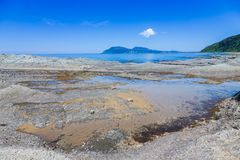 Cape Stolbchaty. Cape on the west coast of the island of Kunashir. It is composed of layers of basaltic lavas of the Mendeleyev v. Olcano royalty free stock images