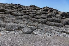 Cape Stolbchaty. Cape on the west coast of the island of Kunashir. It is composed of layers of basaltic lavas of the Mendeleyev v. Olcano stock images