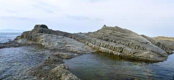 Cape Stolbchatyy. island Kunashir Stock Photos