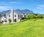 Cape-style house against blue misty mountains Royalty Free Stock Image