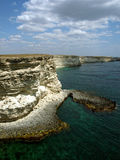 Cape Tarhankut in Crimea, Black sea. Rocky shore of Cape in Ukraine with cloudy sky Royalty Free Stock Photo