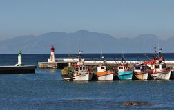 Cape Town Boats. Fishing boats in harbour at Kalk Bay fishing village near Cape Town Stock Images