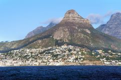 Cape Town and coast line, jetty. Far mountain on the blue sky background. stock images