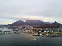 Cape Town and coast line, jetty. Are ships and boats, far mountain on the blue sky background. stock image