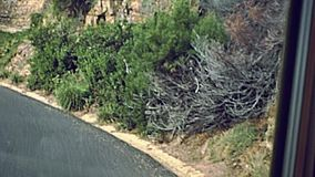 Cape Town coastal drive. Aerial view of Chapman`s Peak Drive, Cape Town, South Africa, one of the most beautiful streets in the world. Historical archival stock video footage
