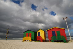 Cape Town Colour Boxes. Grey storm clouds approaching brightly coloured bathing boxes near Cape Town Stock Photography