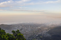 Cape Town covered in fog at sunset Royalty Free Stock Photos