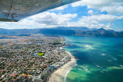 Cape Town, false bay and coast as seen from small plane. Houses, beach and ocean as seen from from a cessna Royalty Free Stock Photos