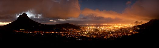 Cape Town at night (South Africa). Panoramic night view of Cape Town (South Africa) with the Lions Head Mountain on the left and the Table Bay in the background stock images