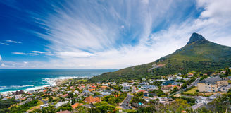 Cape Town panoramic landscape. Camps Bay and Lion's Head mountain, amazing panoramic landscape of a coastal city, part of a Table Mountain National Park, Cape Stock Photography