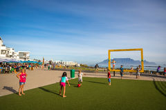 Cape Town, South Africa. April 15th 2015 - Kids playing in Cape Town with the Table mountain in the background Royalty Free Stock Photos