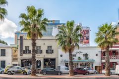 Street scene, with businesses, vehicles, palm trees, in Cape Tow. CAPE TOWN, SOUTH AFRICA, AUGUST 17, 2018: A street scene, with businesses, vehicles and palm stock images