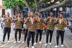CAPE TOWN, SOUTH AFRICA - DECEMBER 23, 2017: group of young men in national african costumes dancing and singing presenting their. Musical band in Victoria and royalty free stock photos