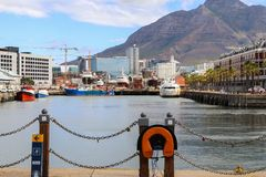 CAPE TOWN, SOUTH AFRICA - DECEMBER 23, 2017: Victoria and Alfred Waterfront area with Devil peak at background. Popular touristic royalty free stock photography