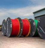 Cable manufacturers with large rolls of cable. Cape Town, South Africa - 2 February, 2017: Large cable rolls at cable manufacturing plant Royalty Free Stock Photography