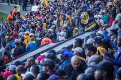 CAPE TOWN, SOUTH AFRICA, 12 May 2018 - Diverse South African football supporters celebrating during PSL football match. Stock Photo