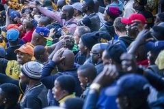 CAPE TOWN, SOUTH AFRICA, 12 May 2018 - Diverse South African football supporters disagreeing with a decision during football game. Stock Photo
