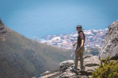 Abseiling instructor on the top of Table Mountain in Cape Town. CAPE TOWN, SOUTH AFRICA - NOVEMBER, 2018: Abseiling instructor on the top of Table Mountain in stock images