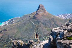 Abseiling instructor on the top of Table Mountain in Cape Town royalty free stock photos