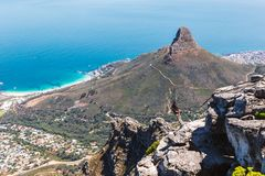 Abseiling instructor on the top of Table Mountain in Cape Town. CAPE TOWN, SOUTH AFRICA - NOVEMBER, 2018: Abseiling instructor on the top of Table Mountain in stock image