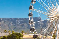 Ferris wheel and Table Mountain view at Waterfront in Cape Town stock photo