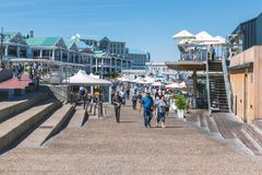 People walking and resting at famous Cape Town Waterfront royalty free stock photo
