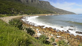 Cape Town South Africa. Scenic view along the coastal road at the back of famous Table Mountain and the 12 Apostles in Cape Town, South Africa, in high stock footage