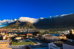 Cape Town, Table Mountain. By a beautiful summer, a big cloud has formed on the Table Mountain in Cape Town, South Africa Stock Images