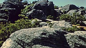 Cape Town Table Mountain nature reserve. CAPE TOWN, South Africa - CIRCA 1980: Table Mountain nature reserve, top of the mountain with building and tourists stock video footage