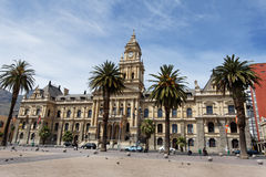Cape Town Town House. The facade of the historical town house with its clock tower and palm trees in downtown Cape Town, South Africa Stock Photos