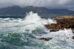 Cape Town Waves. Rough seas crash onto rocks at Kalk Bay near Cape Town Stock Photography