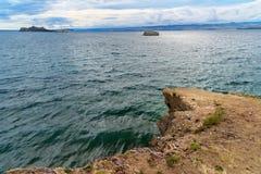 Cape Uyuga. Maloe More on Lake Baikal. Russia. View of Cape Uyuga. Maloe More on Lake Baikal in the morning. Russia Stock Photos